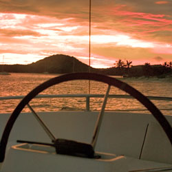 Pride-Travel-Festiva-zeiljacht-lagune-catamaran-sunset-wheel
