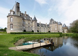 Pride-Travel-Chateau-de-Normandie-1-castle-exterior-outside-lake-dock